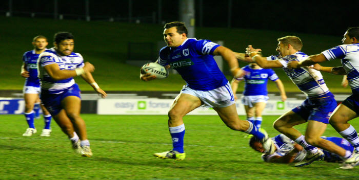 Barnstorming Newtown front rower and cult-hero Ryan 'Rhino' Verlinden on his way to scoring the first of two tries against the Bulldogs as partner-in-crime Ray Moujalli watches on. Both men proved a real handful for Canterbury in the Jets' win.