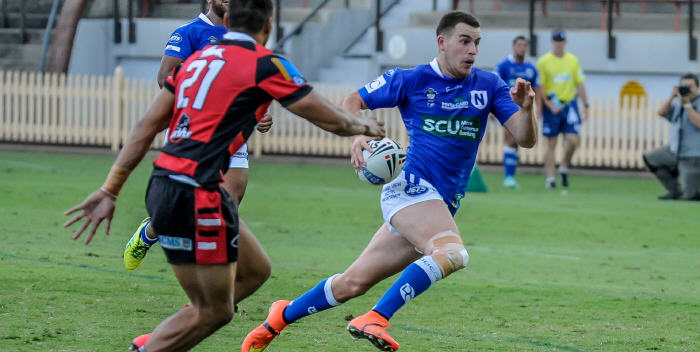 Newtown Jets five-eighth Dallas Wells accelerates to beat a North Sydney opponent at North Sydney Oval last Sunday. Photo: Gary Sutherland Photography