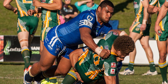 Man mountain Newtown Jets front-rower Saulala Houma makes short work of an unlucky Wyong Roos opponent last Sunday. Photo: Mario Facchini Photography