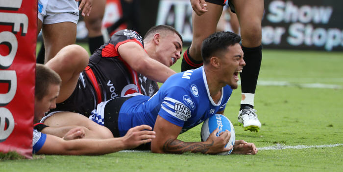 The mercurial Jaline Graham scores for the Newtown Jets with his first touch of the football against the New Zealand Warriors in Auckland on Sunday. Photo: Photosport NZ.