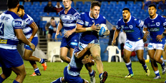 Newtown winger Jacob Gagan was in top form against the Canterbury Bulldogs at Belmore Sports Ground on Friday night. Two of his Jets team-mates Malakai Houma (on the left) and Fa'amanu Brown are also in this action shot taken by Mike Magee. Photo: Michael Magee Photography.