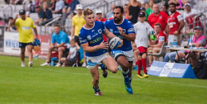 Newtown's strongly-built centre Jordan Drew makes a break against the Illawarra Cutters at WIN Stadium last Saturday, with Jets winger Travis Robinson in close support. Photo: Mario Facchini Photography.