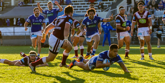 Newtown Jets half-back Fa'amanu Brown weaves his way through the Manly-Warringah defence to score the equalising try in the 78th minute. His subsequent conversion gave the Jets a near-miraculous 40-38 win over the men from the Peninsula. Photo: Mario Facchini Photography