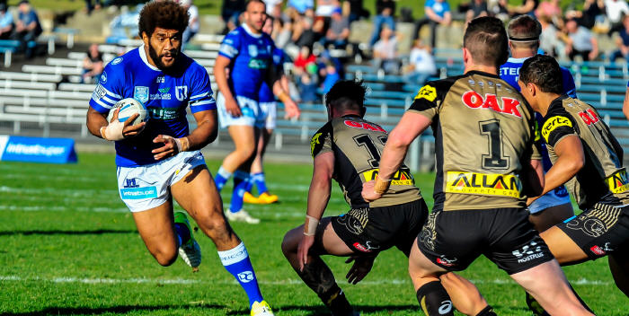 Crowd favourite Junior Roqica takes on the Penrith defense during last Saturday's hard fought victory at Henson Park. Photo: Gary Sutherland Photography