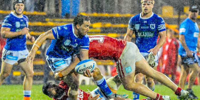 Just in case you weren't aware – there was some heavy rain at Leichhardt Oval on Sunday night. Newtown's hard-working forward Jason Schirnack is tackled by two Illawarra Cutters opponents, with team-mates Josh Cleeland (left) and Matt McIlwrick in close proximity. Photo: Gary Sutherland Photography
