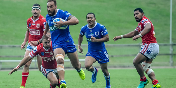 Giant Samoan international prop Sam Tagataese breaks through for the Jets against Illawarra on Saturday, with Newtown five-eighth Penani Manumalealii looming up in support. Photo: Gary Sutherland Photography