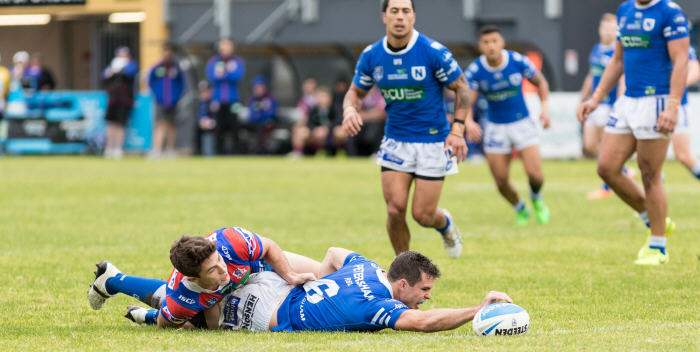 Newtown Jets five-eighth Daniel Mortimer scoring a remarkably-determined individual try against the Newcastle Knights in the 14 Round ISP NSW match played at Cessnock Sports Ground on Saturday. Photo: MAF Photography (Mario Facchini)