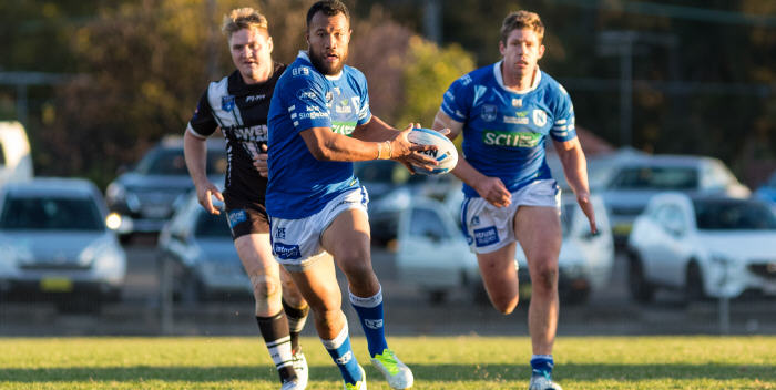 Newtown's five-eighth Joseph Paulo takes the ball forward against Wentworthville at Henson Park on Saturday, with Jets front-rower Jeremy Latimore looming up in support. Photo: Mario Facchini (MAF Photography)