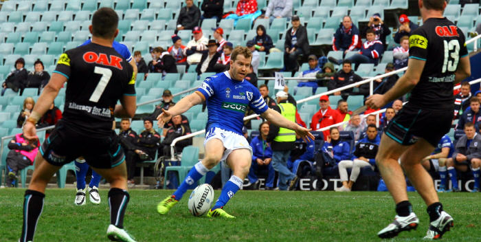 Scott Dureau kicks the winning field goal for the Jets in Newtown's exciting 31-30 win against Penrith at Allianz Stadium on Saturday, 19th July 2014. Photo: Mario Facchini, mafphotography