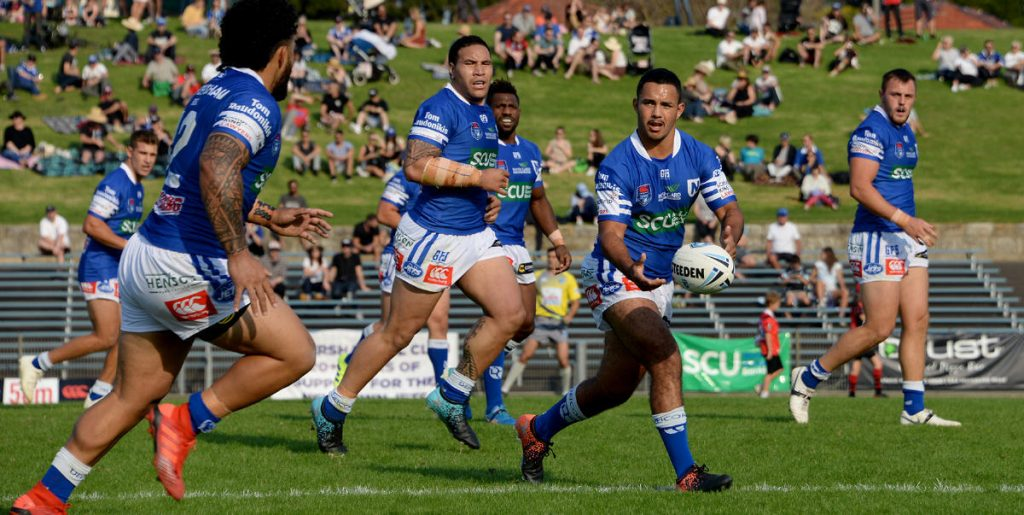 Newtown Jets halfback and ace goal-kicker Braydon Trindall looks to pass to backrower Siosifa Talakai in last Saturday's nerve-wracking 32-30 win against North Sydney at Henson Park. Photo: Michael Magee Photography.