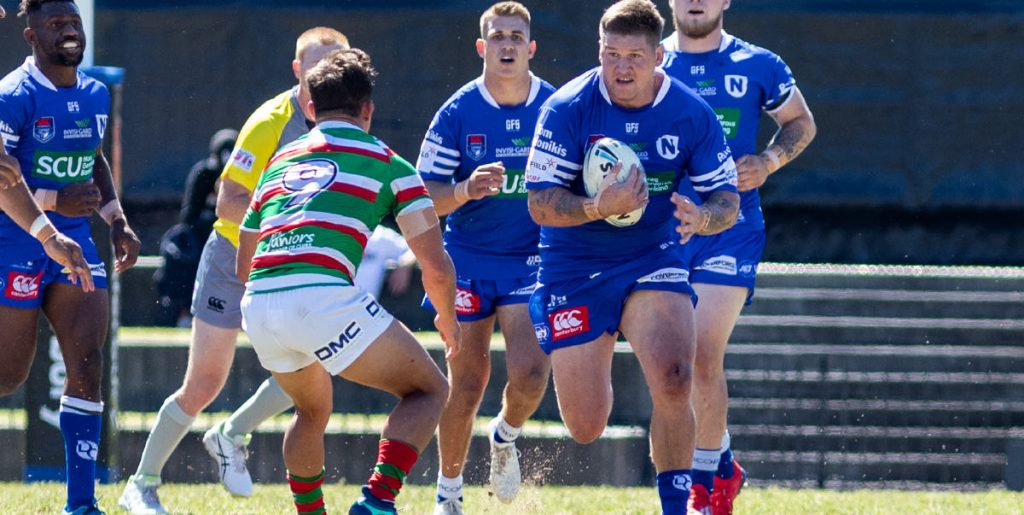 Newtown Jets lock Greg Eastwood is in possession in last Sunday's South Sydney v Newtown match at the Metricon High Performance Centre (Redfern Oval). The Newtown players in the background are (from left) James Segeyaro (hooker), replacement five-eighth Luke Polselli and front-rower Daniel Vasquez. Photo: Mario Facchini, mafphotography