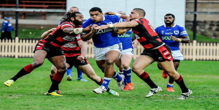 Newtown Jets front-rower Saulala Houma rips into the North Sydney Bears defence on Sunday at North Sydney Oval.