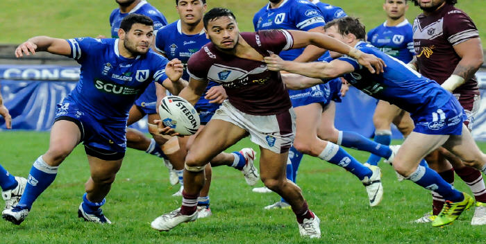 Despite the attention of several Newtown Jets defenders, this Manly-Warringah player looks to get his pass away in Saturday's NSW Cup match at Brookvale Oval