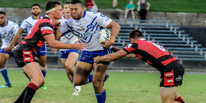 Newtown Jets forward Winstone Asotasi shows the strain as he takes on the North Sydney Bears defence at Henson Park on Saturday evening.  Photo: Gary Sutherland Photography