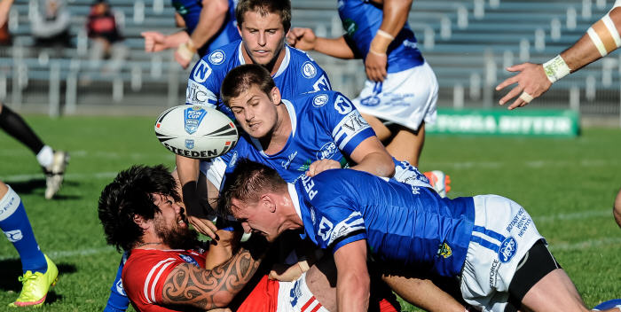 This Illawarra Cutters forward is dealt with by Newtown Jets defenders (from top down) Todd Murphy, Blake Ayshford and Andrew Pearn in the NSW Cup match at Henson Park last Saturday. Photo: Gary Sutherland Photography.
