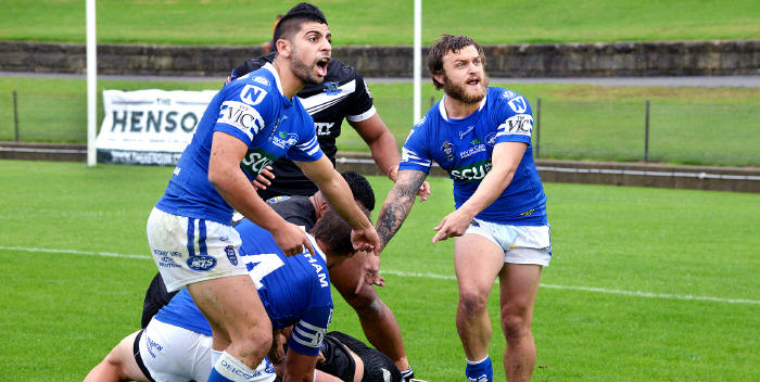 Fair go ref … Newtown Jets players (from left) Daniel Abou-Sleiman, Blake Ayshford (Number 4) and Nathan Gardner question the referee's ruling in a tense moment in a NSW Cup match at Henson Park earlier this year. Photo: Michael Magee Photography.