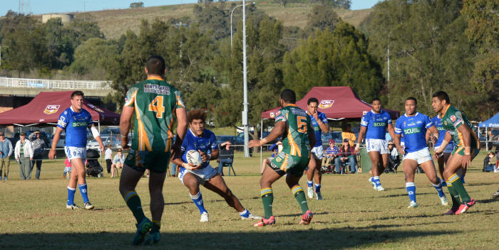 Newtown Jets second-rower Junior Roqica looks to step past a Wyong Roos defender in the NSW Cup match at Olympic Park, Muswellbrook last Saturday. The Jets will need to be at the top of their game this weekend in Wollongong to retain the Tom Kirk Cup. Photo: Ben Murphy (Muswellbrook Chronicle).