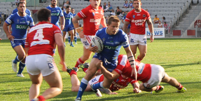 Newtown Jets halfback Todd Murphy tries to break past these Illawarra Cutters defenders at WIN Stadium, Wollongong last Saturday. Photo: Jake Bull Photography