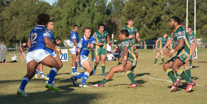 Newtown Jets halfback Todd Murphy gets his pass away in last Saturday's NSW Cup match against Wyong at Olympic Park, Muswellbrook. Photo: Ben Murphy (Muswellbrook Chronicle).