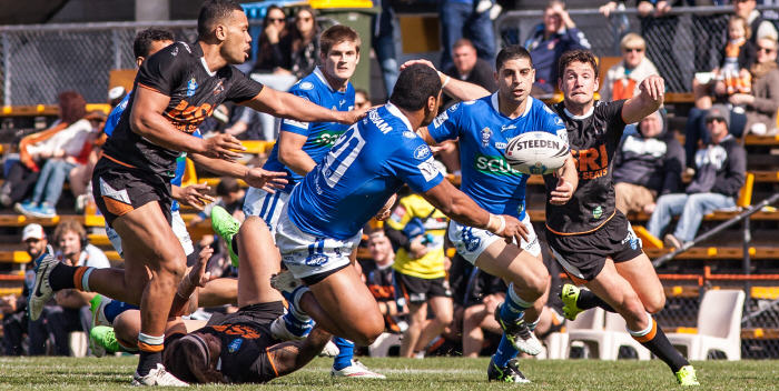 Newtown Jets front-rower Saulala Houma gets his pass away to Daniel Abou-Sleiman at Leichhardt Oval last Saturday. Photo: Mario Facchini Photography.