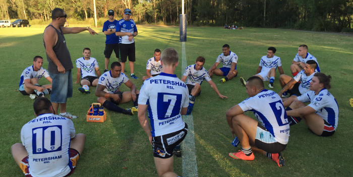 Newtown's head coach Greg Matterson talks to the young Jets triallists at half-time last Thursday evening at Cabramatta. Photo: Wayne Leong.