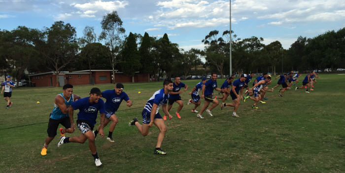 Is this the 2016 Stawell Gift field away to a flying start?  It's actually the Newtown Jets pre-season training squad hard at work at Mahoney Reserve, South Marrickville on the 1st December, 2015.  Strength and conditioning coach Graham Morris (at the rear of the photo) monitors the proceedings.  Photo: Wayne Leong.