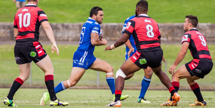 Newtown Jets backrower Jason Schirnack takes the ball forward in the NSW Cup trial against North Sydney at Henson Park on Saturday. Photo: Mario Facchini Photography.