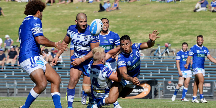 Jets fullback Arana Taumata gets his pass away to Newtown forward Junior Roqica in the Rugby League match against Canterbury-Bankstown at Henson Park last Saturday. Photo: Michael Magee Photography.