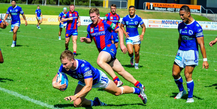 Jordan Drew was signed by the Sharks from the Brisbane Broncos and he has been in top form for the Jets. He is seen here scoring for Newtown against the Newcastle Knights at Cessnock last Saturday. Photo: Gary Sutherland Photography.