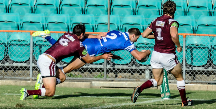 Flying Mitch Brown scores in the corner against Manly in 2015. Photo: Gary Sutherland Photography