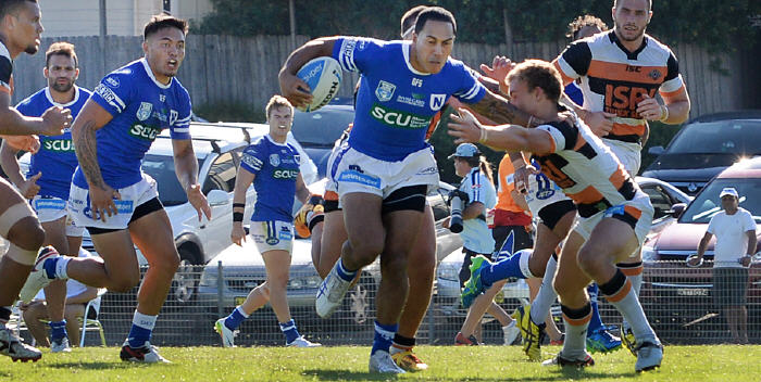 Newtown Jets utility forward Kurt Kara breaks past the Wests Tigers defence, with his team-mates (from the left) Anthony Moraitis, Jaline Graham and Jordan Drew all in the picture. Photo: Michael Magee Photography.