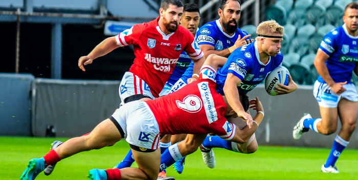 Newtown Jets hooker Matt McIlwrick is tackled by an Illawarra Cutters opponent in a recent Intrust Super Premiership NSW match, with team-mates Fa'amanu Brown, Travis Robinson and Anthony Moraitis in the background. Photo: Gary Sutherland Photography.