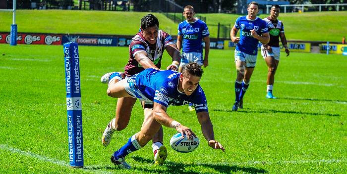 Newtown's very effective winger Jacob Gagan scores against Manly-Warringah at Brookvale Oval last Saturday. Photo: Gary Sutherland.