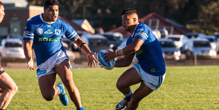 Newtown Jets halfback Fa'amanu Brown dummies to his giant team-mate Malakai Houma in last Saturday's top of the table clash against Mounties at Henson Park. Photo: Mario Facchini Photography.