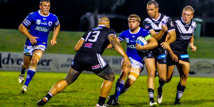 Newtown hooker and captain Matt McIlwrick takes on the Wentworthville defence at Cessnock on Saturday, with Jets second-rower Kurt Capewell moving up in support. Photo: Gary Sutherland Photography.