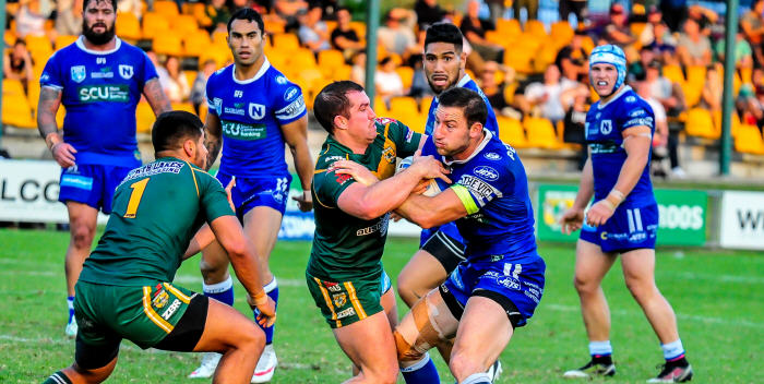 Newtown Jets fullback and captain Mitch Brown confronts the Wyong Roos defence, with his team-mates (from left to right) David Fifita, Arana Taumata, Jesse Sene-Lefao and Josh Cleeland in the background. Photo: Gary Sutherland Photography.