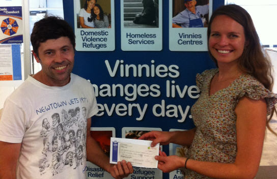 Jets' General Manager Stuart McCarthy presents a cheque to Zan Schmidt from Vinnies for Elsie Women's Refuge.