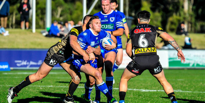 Newtown's skilful backrower Kurt Capewell is confronted by the Penrith Panthers defence last Saturday, with Jets team-mate and frontrower Harrison Muller in support. Photo: Gary Sutherland Photography.