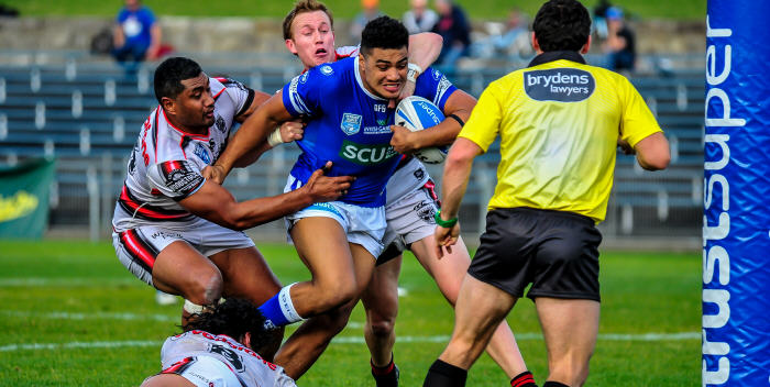 Newtown Jets front-rower Malakai Houma crashes through the New Zealand Warriors defence at Henson Park last Saturday. Photo: Gary Sutherland Photography
