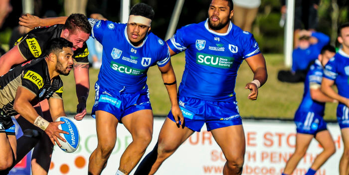 Even the presence of the formidable Houma brothers, Malakai (left) and Saulala, was not enough to stem the tide against a very strong Penrith Panthers team. Photo: Gary Sutherland Photography