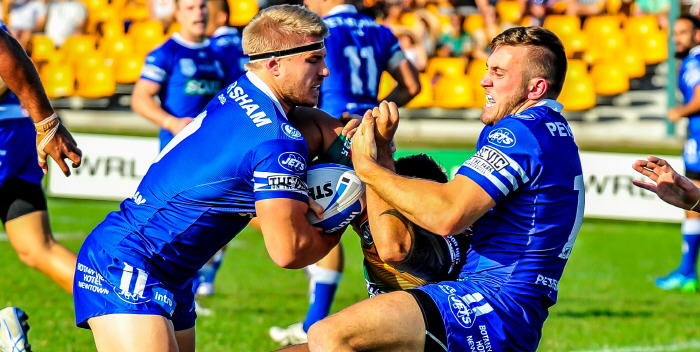 Newtown Jets forwards Matt McIlwrick (left) and Kurt Capewell bail up a Wyong opponent in their recent ISP NSW match. Photo: Gary Sutherland Photography.