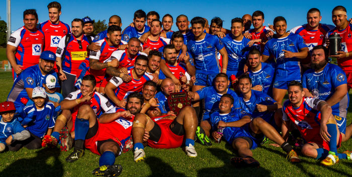 The Chilean and El Salvador national Rugby League teams get together after Chile's 58-20 win at Henson Park on Saturday, 11th June 2016. Chile wore their red, white and blue national colours while El Salvador wore their country's blue and white colours. With their victory, Chile claimed the inaugural El Escudo del Desafio, the Shield of Defiance. Photo: Mario Facchini Photography.