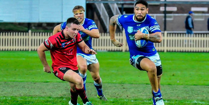 Newtown front-rower Jesse Sene-Lefao takes the ball up for the Jets against the North Sydney Bears last Sunday, with team-mate and hooker Matt McIlwrick in support. Photo: Gary Sutherland Photography.