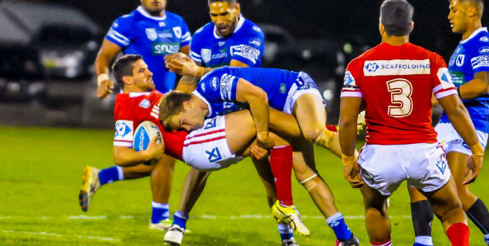 Newtown Jets centre Jordan Drew shows no quarter to an Illawarra Cutters opponent at Henson Park on Friday night. Photo: Gary Sutherland Photography