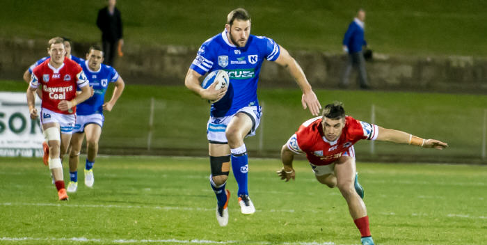 Newtown Jets captain and centre Mitch Brown dashes away to score against the Illawarra Cutters at Henson Park on Friday night. Photo: Gary Sutherland