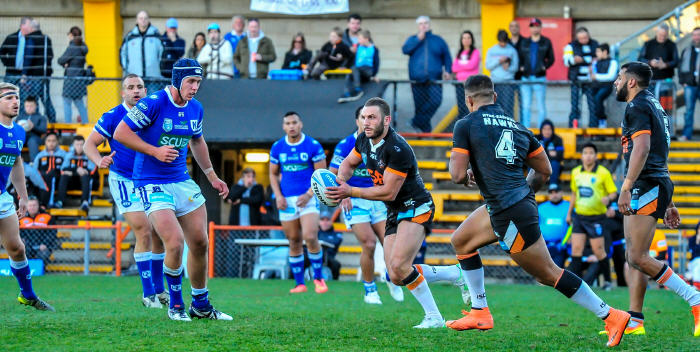 Wests Tigers hooker Robbie Farah has the full attention of these Newtown Jets defenders as he takes the ball forward in last Saturday's Intrust Super Premiership NSW match at Leichhardt Oval. Photo: Gary Sutherland Photography