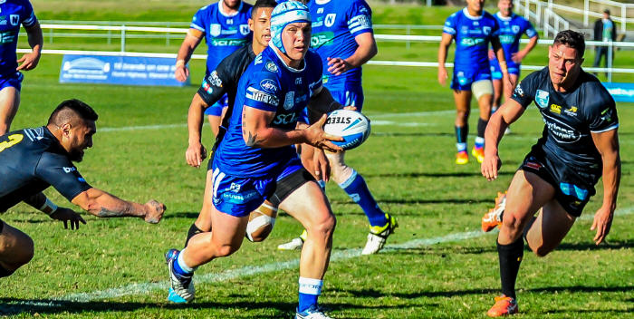 Newtown Jets five-eighth Josh Cleeland carrying the ball in the textbook style as he challenges the Mounties defensive line last Saturday. Photo: Gary Sutherland Photography