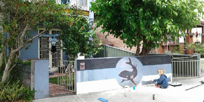 In readiness for Sunday's NRL Grand Final, seven year old Edward puts the finishing touches on his masterpiece out front of the family home in Marrickville. Both Edward & dad Peter are Mad Jets & Cronulla supporters. Go Sharkies!