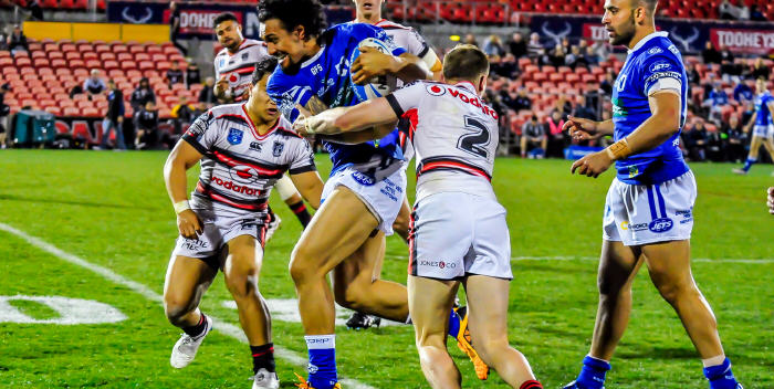Hard-running Newtown Jets centre Kenny Niko (with the ball) looks to break through the New Zealand Warriors defence on Sunday evening at Penrith. His team-mate Anthony Moraitis (on the right) is in close attendance. Photo: Gary Sutherland Photography