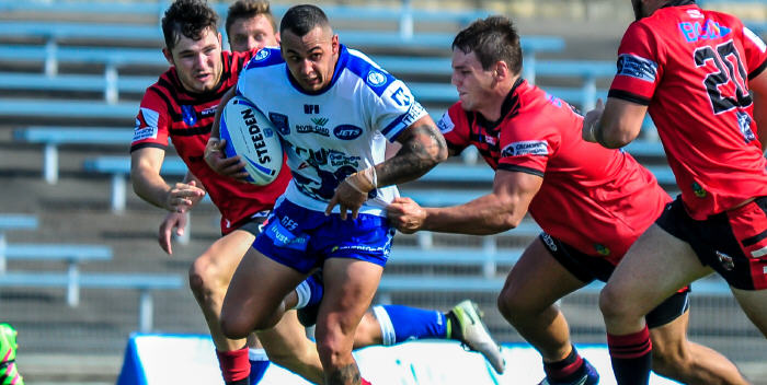 Newtown Jets centre Saxon Onur is about to be rounded up by these North Sydney Bears defenders at Henson Park last Saturday. Photo: Gary Sutherland Photography